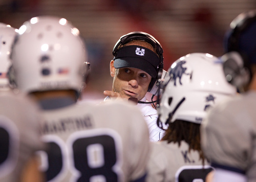 Utah State head coach Matt Wells talks to his team during the second half of an NCAA college football game against New Mexico, Saturday, Oct. 19, 2013, at University Stadium in Albuquerque, N.M. Utah State won 45-10. (AP Photo/Eric Draper)