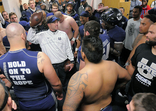 Utah State head coach Matt Wells celebrates with his team in the locker room after they defeated Wyoming 35-7 in an NCAA college football game on Saturday, Nov. 30, 2013, in Logan, Utah. (AP Photo/The Herald Journal, Eli Lucero)