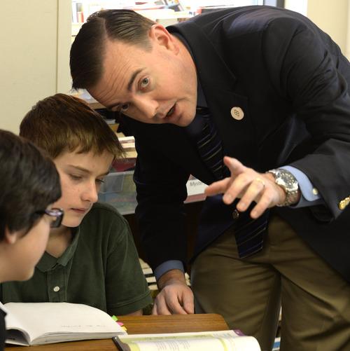 Rick Egan  | The Salt Lake Tribune   West Valley City Mayor Mike Winder helps Brandon Butterfield, a sixth-grader at Endeavor Hall Charter School, write a letter inviting President Obama to visit Utah, Thursday, December 5, 2013.
