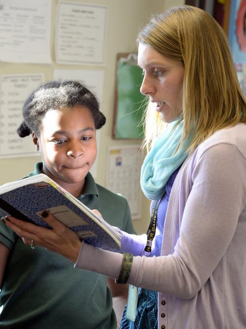 Rick Egan  | The Salt Lake Tribune   Teacher Emily Daugherty reads sixth-grader Reagan Tolley's letter inviting President Obama to visit Utah, at Endeavor Hall Charter School, Thursday, December 5, 2013.