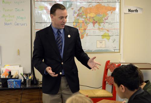 Rick Egan  | The Salt Lake Tribune   West Valley City Mayor Mike Winder helps sixth-graders at Endeavor Hall Charter School write letters inviting President Obama to visit Utah, Thursday, Dec. 5, 2013.