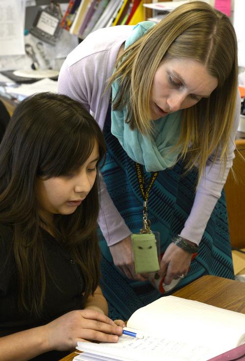 Rick Egan  | The Salt Lake Tribune   Teacher Emily Daugherty helps Darlynn Tovar, a sixth-grader at Endeavor Hall Charter School, write a letter inviting President Obama to visit Utah, Thursday, Dec. 5, 2013.