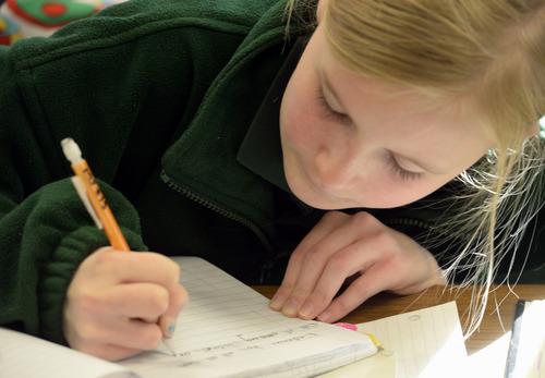 Rick Egan   |  The Salt Lake Tribune   Maya Jowers, a sixth-grader at Endeavor Hall Charter School, writes a letter inviting President Obama to visit Utah, Thursday, Dec. 5, 2013.