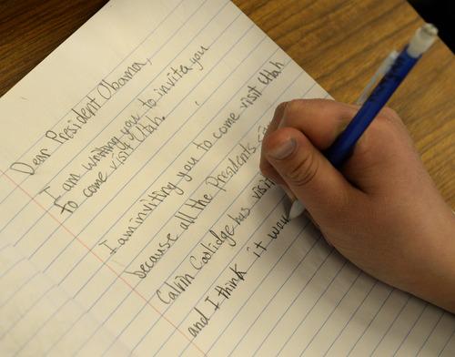 Rick Egan  | The Salt Lake Tribune   A student at Endeavor Hall Charter School in West Valley City writes a letter inviting President Barack Obama to visit Utah, Thursday, Dec. 5, 2013.