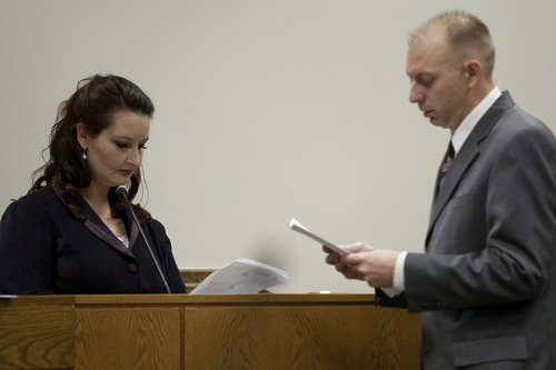 Gypsy Willis, left, who was in an extramarital affair with Martin MacNeill, reviews material presented by Sam Pead, Utah County Prosecutor, during MacNeill's trial at the Fourth District Court in Provo Tuesday, Oct. 29, 2013.   MARK JOHNSTON/Daily Herald