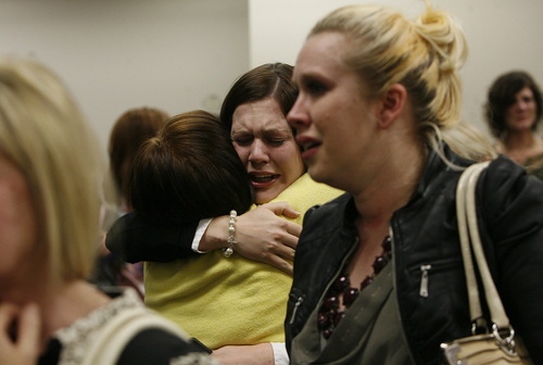Scott Sommerdorf   |  The Salt Lake Tribune Alexis Somer, center, is hugged after the court adjourned following the vedicts against Martin MacNeill were given. Martin MacNeill was found guilty of murder and obstruction of justice early Saturday morning, November 9, 2013.