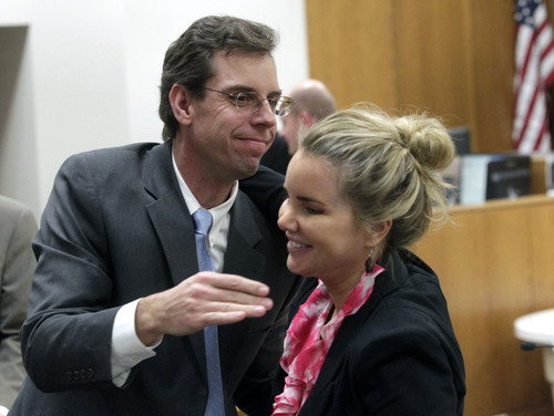 Al Hartmann  |  The Salt Lake Tribune Defense lawyer Randy Spencer congratulates co-defense counselor Susane Gustin at the conclusion of Martin MacNeill's three week murder trial in Provo, Utah 4th District Court Friday November 8, 2013.