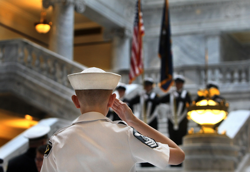 Scott Sommerdorf   |  The Salt Lake Tribune A young Naval Sea Cadet salutes during the posting of the colors in the rotunda of the Utah State Capitol on Saturday. The Great Salt Lake Division of the Naval Sea Cadet Corps was recommissioned as the NSCC Battleship Utah (BB-31), allowing a closer tie to the Navy and the State of Utah and to honor the USS Utah as well as her crew members who served and went down with her.
