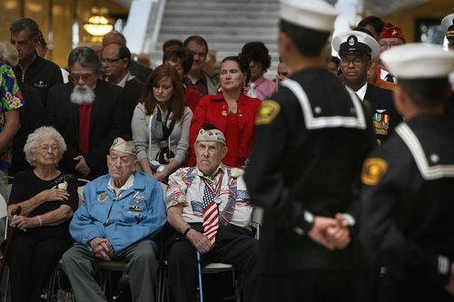 Scott Sommerdorf   |  The Salt Lake Tribune Pearl Harbor survivors Dewey D. Farmer, left with his wife Helen, and Glen Allgood, center, listen on Saturday to a part of the ceremony in the capitol rotunda, where those who died at Pearl Harbor were remembered. The Great Salt Lake Division of the Naval Sea Cadet Corps was recommissioned as the NSCC Battleship Utah (BB-31), allowing a closer tie to the Navy and the State of Utah and to honor the USS Utah as well as her crew members who served and went down with her.The Great Salt Lake Division of the Naval Sea Cadet Corps was recommissioned as the NSCC Battleship Utah (BB-31), allowing a closer tie to the Navy and the State of Utah and to honor the USS Utah as well as her crew members who served and went down with her, Saturday December 7, 2013.