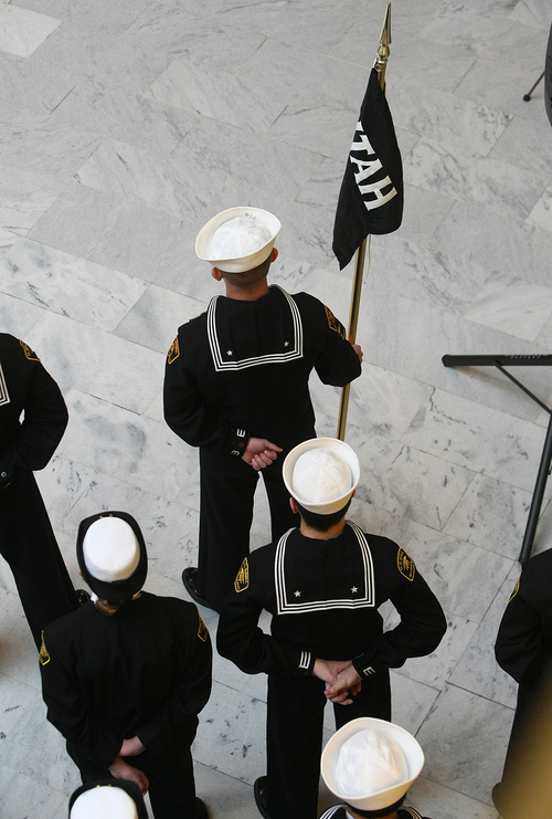 Scott Sommerdorf   |  The Salt Lake Tribune Cadets stand with the pennant that represents their newly commissioned group name. The Great Salt Lake Division of the Naval Sea Cadet Corps was recommissioned as the NSCC Battleship Utah (BB-31), allowing a closer tie to the Navy and the State of Utah and to honor the USS Utah as well as her crew members who served and went down with her, Saturday December 7, 2013.