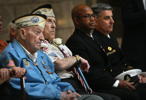 Scott Sommerdorf   |  The Salt Lake Tribune Pearl Harbor survivors Dewey D. Farmer, left, and Glen Allgood, next to him, listen to the ceremony in the capitol rotunda near active naval officers, Saturday December 7, 2013.  The Great Salt Lake Division of the Naval Sea Cadet Corps was recommissioned as the NSCC Battleship Utah (BB-31), allowing a closer tie to the Navy and the State of Utah and to honor the USS Utah as well as her crew members who served and went down with her.