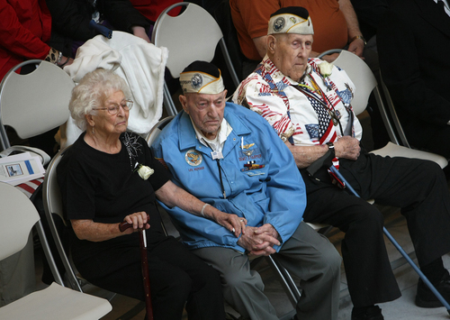 Scott Sommerdorf   |  The Salt Lake Tribune Pearl Harbor survivors Dewey D. Farmer, left with his wife Helen, and Glen Allgood, right, listen to the ceremony in the capitol rotunda, Saturday December 7, 2013.  The Great Salt Lake Division of the Naval Sea Cadet Corps was recommissioned as the NSCC Battleship Utah (BB-31), allowing a closer tie to the Navy and the State of Utah and to honor the USS Utah as well as her crew members who served and went down with her.