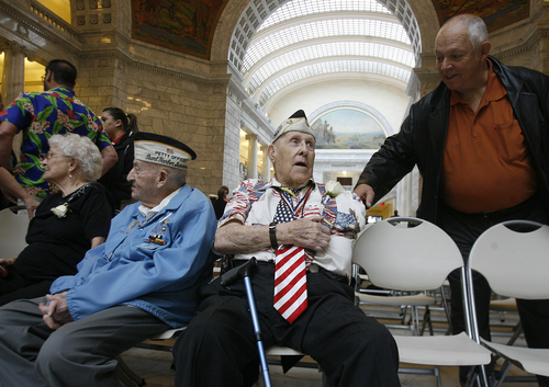 Scott Sommerdorf   |  The Salt Lake Tribune Pearl Harbor survivors Dewey D. Farmer, left with his wife Helen, and Glen Allgood, center, after the ceremony in the capitol rotunda, Saturday December 7, 2013.  The Great Salt Lake Division of the Naval Sea Cadet Corps was recommissioned as the NSCC Battleship Utah (BB-31), allowing a closer tie to the Navy and the State of Utah and to honor the USS Utah as well as her crew members who served and went down with her.