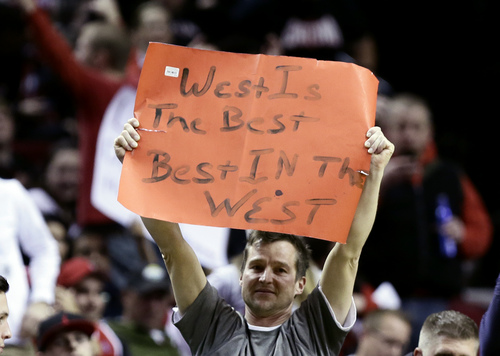 A Portland Trail Blazer fan holds up a sign after their 130-98 win over the Utah Jazz in  an NBA basketball game in Portland, Ore., Friday, Dec. 6, 2013. The Trail Blazers have a 17-3 win-loss record after tonight's game. (AP Photo/Don Ryan)