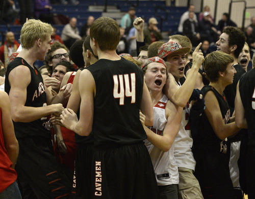 Rick Egan  | The Salt Lake Tribune   American Fork celebrates their last secont win Overland, Colorado in the Great Western Shootout, at Orem High, Friday, December 6, 2013