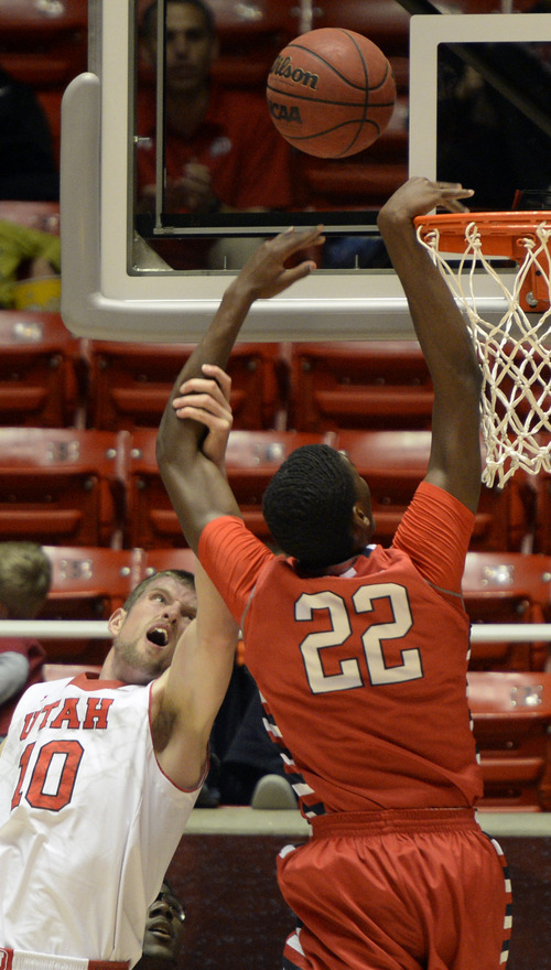 Rick Egan    The Salt Lake Tribune   Utah Utes forward Renan Lenz (10) stops Fresno State Bulldogs guard/forward Paul Watson (22) from scoring a basket, but is called for a personal foul on the play,  in basketball action Utah vs. Fresno State, in the Huntsman Center, Saturday, December 7, 2013.
