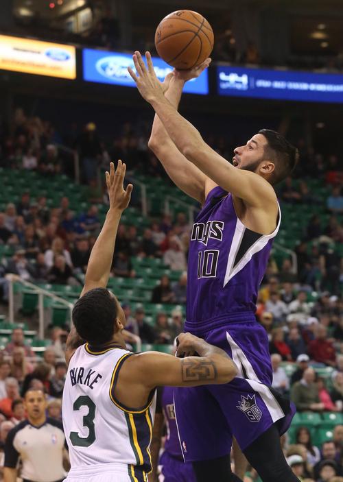 Utah Jazz's Trey Burke (3) defends as Sacramento Kings' guard Greivis Vasquez (10) takes a shot in the first half of an NBA basketball game on Saturday, Dec. 7, 2013, in Salt Lake City. (AP Photo/Kim Raff)