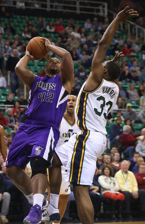 Sacramento Kings' Chuck Hayes (42) shoots as Utah Jazz's forward Mike Harris (33) defends in the first half of an NBA basketball game on Saturday, Dec. 7, 2013, in Salt Lake City. (AP Photo/Kim Raff)