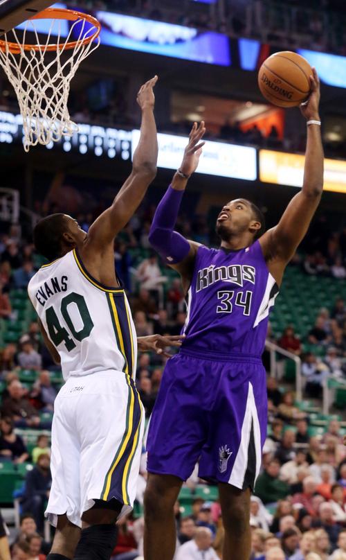 Utah Jazz's Jeremy Evans (40) defends as Sacramento Kings' Jason Thompson (34) shoots the ball in the first half of an NBA basketball game on Saturday, Dec. 7, 2013, in Salt Lake City. (AP Photo/Kim Raff)