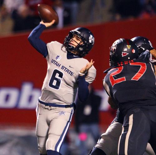 Utah State's Darell Garretson tosses a pass in the first half of an NCAA college football game in Fresno, Calif., Saturday, Dec. 7, 2013. (AP Photo/Gary Kazanjian)