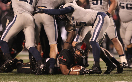 Fresno State's Josh Quezada is stopped short of a first down in the second half of an NCAA college football game in Fresno, Calif., Saturday, Dec. 7, 2013. (AP Photo/Gary Kazanjian)