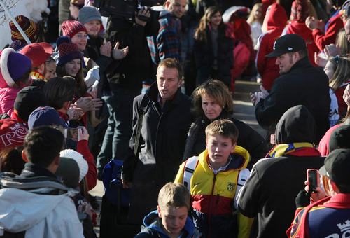 Scott Sommerdorf      The Salt Lake Tribune RSL fans greet head coach Jason Kreis as he and other Real Salt Lake players and coaches make their way through a sea of fans after arriving in Salt Lake at the TAC Air sports terminal, Sunday December 8, 2013.