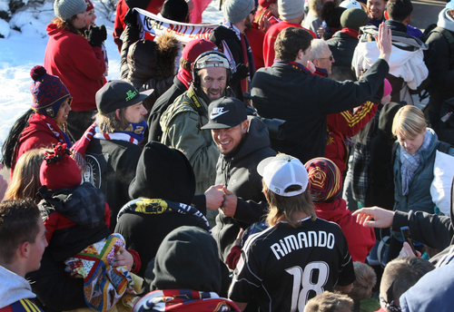 Scott Sommerdorf      The Salt Lake Tribune RSL goalkeeper Nick Rimando gets a knuckle bump from a fan as he makes his way through a sea of fans as he and other Real Salt Lake players and coaches arrive in Salt Lake at the TAC Air sports terminal, Sunday December 8, 2013.