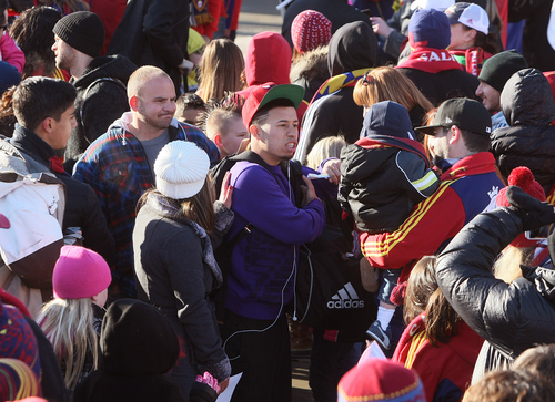 Scott Sommerdorf      The Salt Lake Tribune RSL fans crowd around Sebastian Velasquez as he and other Real Salt Lake players and coaches arrive in Salt Lake at the TAC Air sports terminal, Sunday December 8, 2013.
