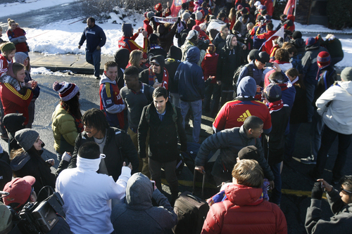 Scott Sommerdorf      The Salt Lake Tribune RSL fans greet Real Salt Lake players and coaches as they make their way through a sea of fans after arriving in Salt Lake at the TAC Air sports terminal, Sunday December 8, 2013.
