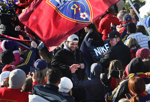 Scott Sommerdorf      The Salt Lake Tribune RSL fans greet Chris Wingert as he and other Real Salt Lake players and coaches as they make their way through a sea of fans after arriving in Salt Lake at the TAC Air sports terminal, Sunday December 8, 2013.