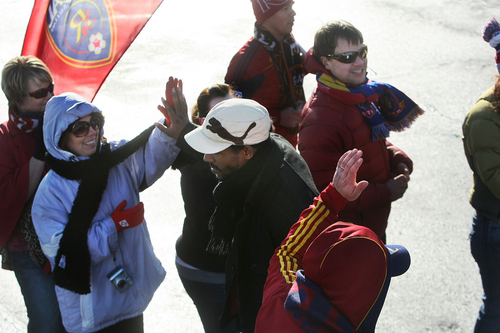 Scott Sommerdorf      The Salt Lake Tribune RSL fans give Real Salt Lake players and coaches high fives as they make their way through a sea of fans after arriving in Salt Lake at the TAC Air sports terminal, Sunday December 8, 2013.