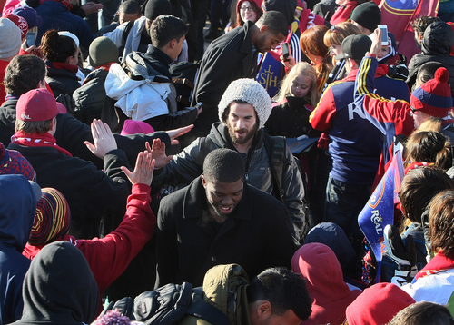 Scott Sommerdorf      The Salt Lake Tribune RSL fans give midfielder Kyle Beckerman high fives as he and other Real Salt Lake players and coaches as they make their way through a sea of fans after arriving in Salt Lake at the TAC Air sports terminal, Sunday December 8, 2013.