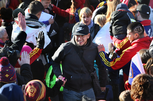 Scott Sommerdorf      The Salt Lake Tribune RSL goalkeeper Nick Rimando is greeted by fans as he makes his way through a sea of fans as he and other Real Salt Lake players and coaches arrive in Salt Lake at the TAC Air sports terminal, Sunday December 8, 2013.