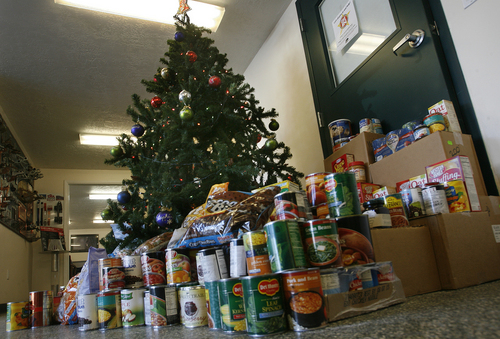 Scott Sommerdorf   |  The Salt Lake Tribune Just some of the donations of food that people have left at Roofers Supply for their holiday charitable drive near the Christmas tree where the donations are kept. Each time they get a full loadit is taken to the Food Bank. This is just one of many collections they have made this season.