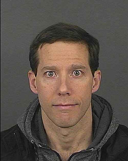 """This photo provided by Denver Police shows Aron Ralston, 38.  Ralston, who cut off his forearm to free himself after becoming trapped by a dislodged boulder in a Utah canyon, was arrested in Denver for domestic violence. He was booked into the Downtown Detention Center on Sunday, Dec. 8, 2013 on charges of assault and wrongs to minors. The case against Ralston has since been dropped by the city attorney. Ralston was hiking in 2003 when he became trapped by a boulder and was forced to cut off his own arm to free himself. He went on to detail his struggles in a book, and his story was later adapted into the movie """"127 Hours.""""  (AP Photo/Denver Police)"""