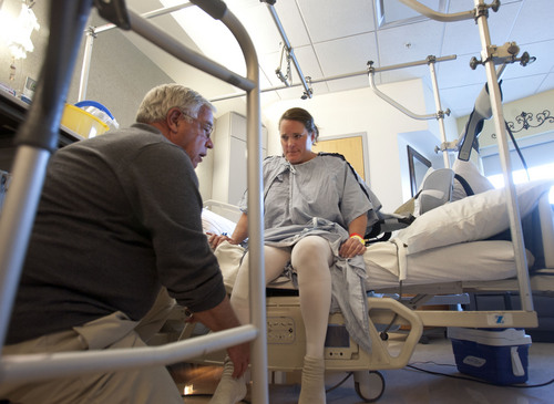 Steve Griffin     The Salt Lake Tribune Julie Harris receives her first dose of physical therapy within 24 hours of having her knee replaced on Thursday, November 7, 2013.