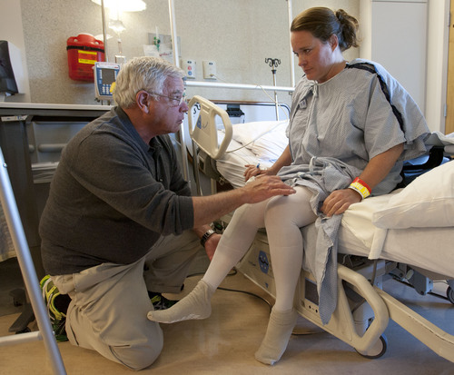 "Steve Griffin  |  The Salt Lake Tribune Knee replacement patient Julie Harris, works on bending her leg with University of Utah physical therapist Chuck Graybill. ""Ninety degrees in less than 24 hours after surgery is awesome,"" he says encouragingly."