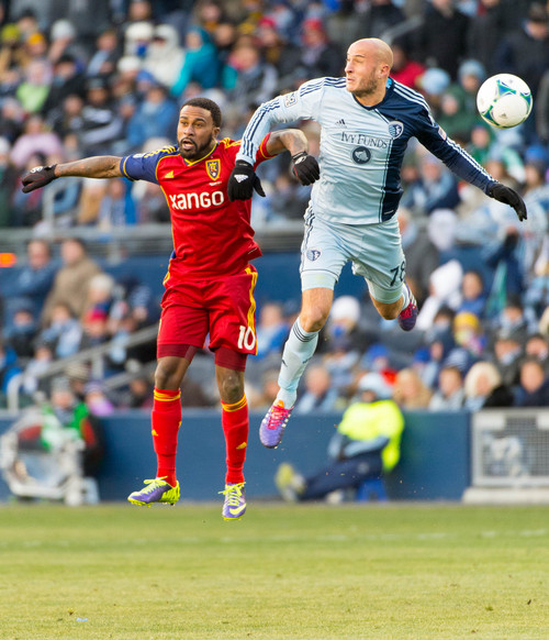 Trent Nelson  |  The Salt Lake Tribune Real Salt Lake's Robbie Findley (10) and Sporting KC's Aurelien Collin (78) leap for the ball as Real Salt Lake faces Sporting KC in the MLS Cup Final at Sporting Park in Kansas City, Saturday December 7, 2013.