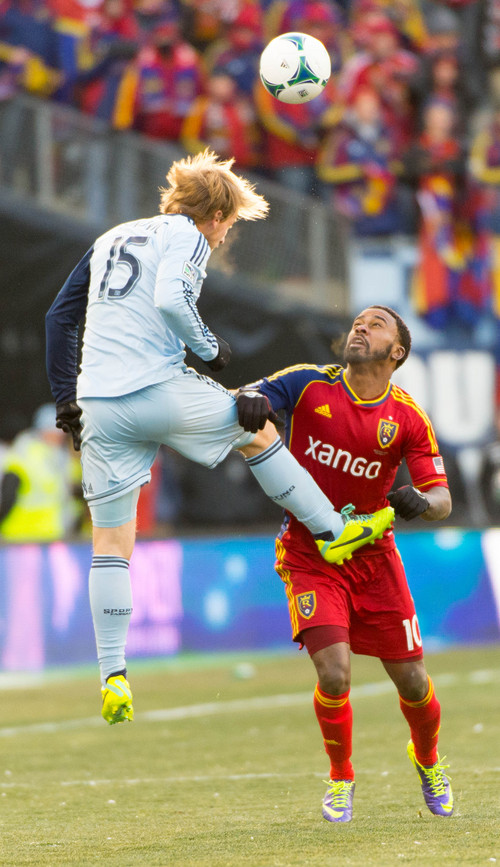 Trent Nelson  |  The Salt Lake Tribune Sporting KC's Seth Sinovic (15) leaps above Real Salt Lake's Robbie Findley (10) as Real Salt Lake faces Sporting KC in the MLS Cup Final at Sporting Park in Kansas City, Saturday December 7, 2013.