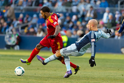 Trent Nelson  |  The Salt Lake Tribune Real Salt Lake's Robbie Findley (10) is tripped up by Sporting KC's Aurelien Collin (78) as Real Salt Lake faces Sporting KC in the MLS Cup Final at Sporting Park in Kansas City, Saturday December 7, 2013.