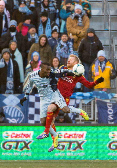 Trent Nelson  |  The Salt Lake Tribune Real Salt Lake's Nat Borchers (6) gets tangled up with Sporting KC's C.J. Sapong (17) as Real Salt Lake faces Sporting KC in the MLS Cup Final at Sporting Park in Kansas City, Saturday December 7, 2013.