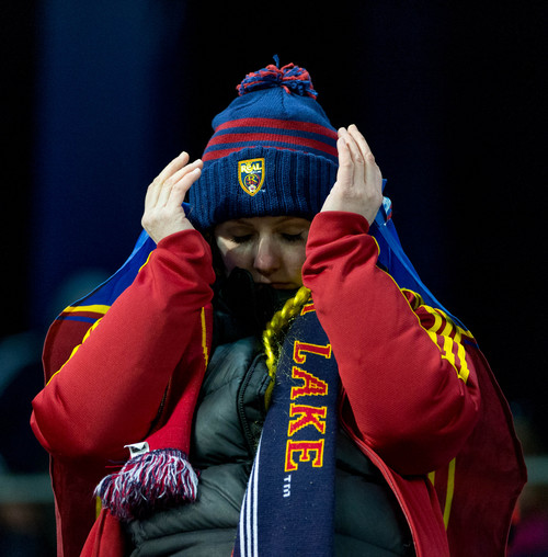 Trent Nelson  |  The Salt Lake Tribune An RSL fan reacts as Sporting KC is awarded the MLS Cup trophy after defeating Real Salt Lake in the MLS Cup Final at Sporting Park in Kansas City, Saturday December 7, 2013.