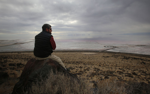 Francisco Kjolseth  |  The Salt Lake Tribune Salt Lake Tribune outdoors writer Brett Prettyman overlooks the Spiral Jetty from Rozel Point. The Spiral Jetty earth works on the North edge of the Great Salt Lake created by artist Robert Smithson in 1970 is visible on Wednesday, Nov. 20, 2013. The 1,500 ft long spiral that is 15 ft wide has been below water many times since its creation in an ever changing landscape.
