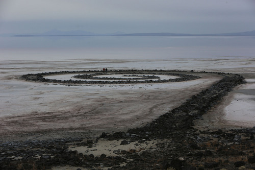 Francisco Kjolseth  |  The Salt Lake Tribune A pair of visitors walks the Spiral Jetty earth works on the North edge of the Great Salt Lake created by artist Robert Smithson in 1970 on Wednesday, Nov. 20, 2013. The 1,500 ft long spiral that is 15 ft wide has been below water many times since its creation in an ever changing landscape.