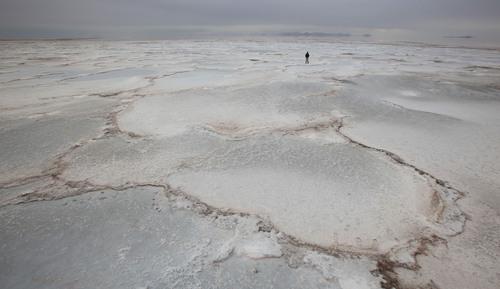 Francisco Kjolseth  |  The Salt Lake Tribune The landscape of the Great Salt Lake takes on the feel of a frozen ice sheet as opposed to salt as Tribune reporter Brett Prettyman takes it all in near the Spiral Jetty on Wednesday, Nov. 20, 2013.