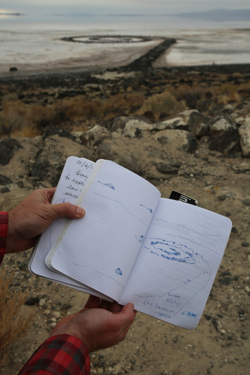 Francisco Kjolseth  |  The Salt Lake Tribune Visitors from near and far sign the log book at the Spiral Jetty earth works on the North edge of the Great Salt Lake created by artist Robert Smithson in 1970 which was visible on Wednesday, Nov. 20, 2013. The 1,500 ft long spiral that is 15 ft wide has been below water many times since its creation in an ever changing landscape.