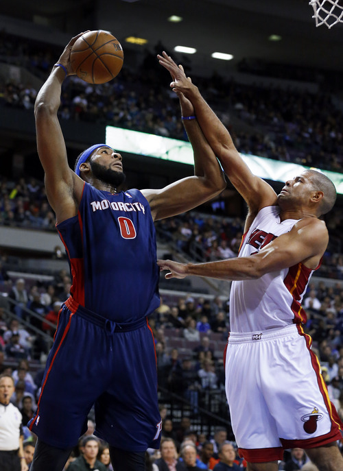 Detroit Pistons center Andre Drummond (0) shoots over Miami Heat small forward Shane Battier in the first quarter of an NBA basketball game in Auburn Hills, Mich., Sunday, Dec. 8, 2013. (AP Photo/Paul Sancya)