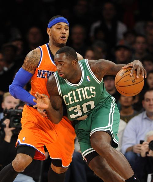Boston Celtics power' Brandon Bass (30) drives the ball around New York Knicks Carmelo Anthony (7) in the first half an NBA basketball game on Sunday, Dec. 8, 2013, in New York. (AP Photo/Kathy Kmonicek)