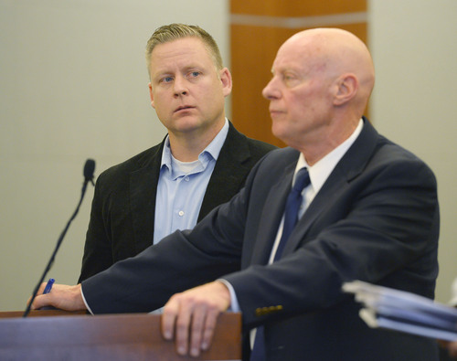 Steve Griffin  |  The Salt Lake Tribune   Chiropractor Brian Babcock, left, listens to his attorney, James Haskins, during his sentencing hearing in Judge Terry L. Christiansen courtroom at the 3rd District Courthouse in West Jordan, Utah Monday, December 9, 2013. Babcock was being sentenced for scamming his elderly, vulnerable clients, who he told he could cure their diabetes and thyroid ailments.