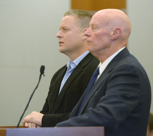 Steve Griffin  |  The Salt Lake Tribune   Chiropractor Brian Babcock, left, and his attorney, James Haskins, listen during his sentencing hearing in Judge Terry L. Christiansen courtroom at the 3rd District Courthouse in West Jordan, Utah Monday, December 9, 2013. Babcock was being sentenced for scamming his elderly, vulnerable clients, who he told he could cure their diabetes and thyroid ailments.